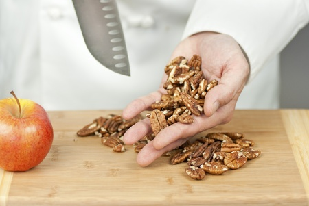 Close-up of a chef displaying pecans. Stock Photo
