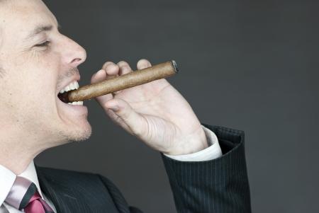 Close-up of a confident businessman celebrating with a cigar. photo