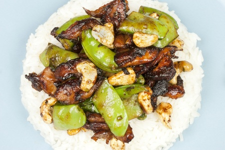 Close-up of chicken cashew on rice. Stock Photo - 10376343
