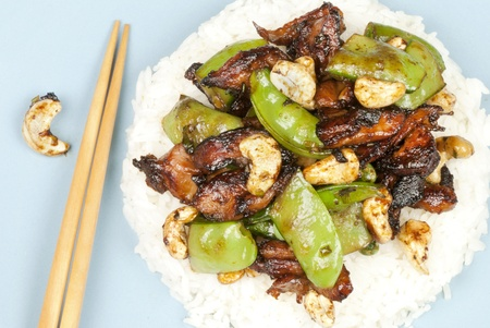 Close-up of chicken cashew on rice with bamboo chopsticks. Stock Photo - 10376344