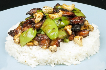 Close-up of chicken cashew snowpea on rice. Stock Photo - 10376341