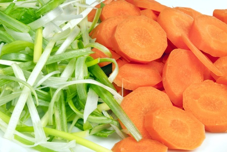 prep: Close-up of carrots and green onions prepared for a stir fry.