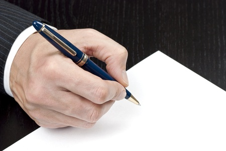 autograph: Close-up of a businessman signing a contract.