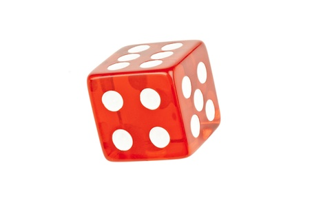 dice: Close-up of a single die rolling showing four, five and six.