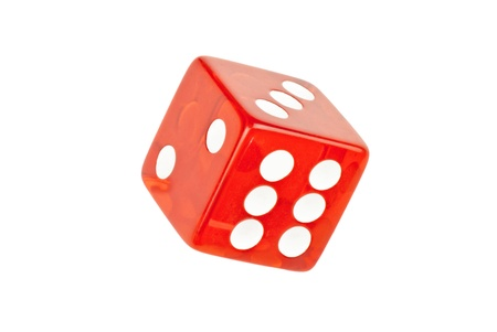 Close-up of a single die rolling six.