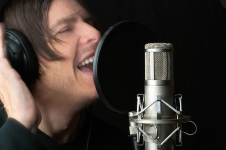 Close-up of a man recording vocals in a sound studio. Stock Photo - 14900638