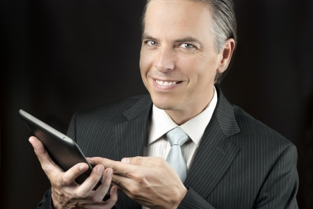 Close-up of a confident businessman using a tablet. photo