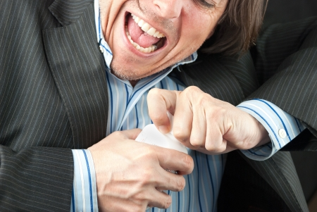Close-up of a casual businessman trying to open a pill bottle. Stock Photo - 14900659