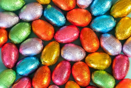 Close-up of pile of colorful chocolate Easter Eggs.
