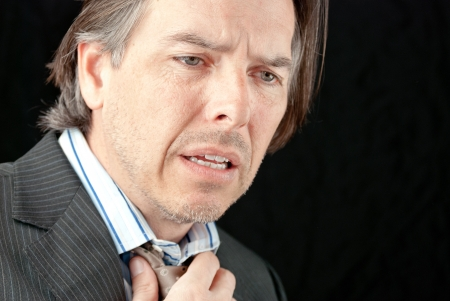 Close-up of a businessman experiencing the onset of a heart attack  photo