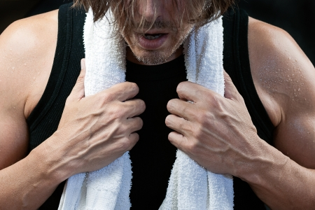 Close-up shot of a man after his workout, front view. photo