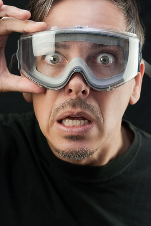 Close-up of a crazy man wearing goggles. photo