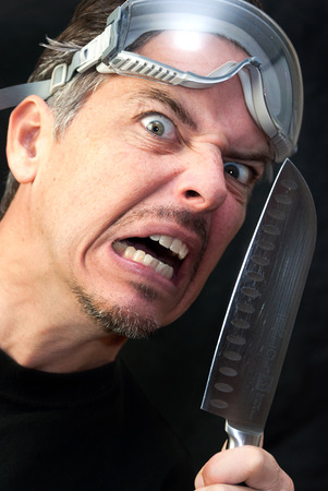psycho: Close-up of a crazy man with a knife. Stock Photo