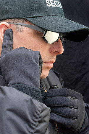Close-up of a close protection officer listening to his earpiece