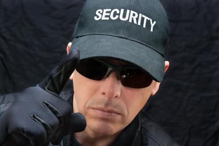 earpiece: Close-up of a close protection officer gives warning