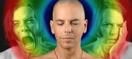 Close-up of a man in three conflicting emotional states  calm   meditative, pain, and depression  Rainbow circle overlaying the meditative state