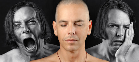 shaved head: Close-up of a man in three conflicting emotional states  calm   meditative, pain, and depression  Pain and depression are in black and white  The meditative state is in color