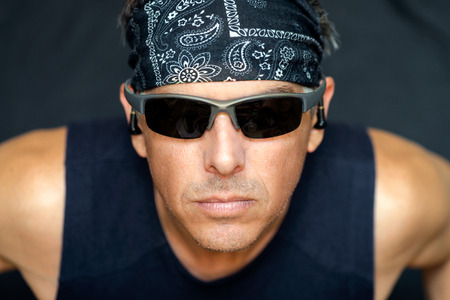 intense: Close-up of intense athletic man looking to camera. Stock Photo