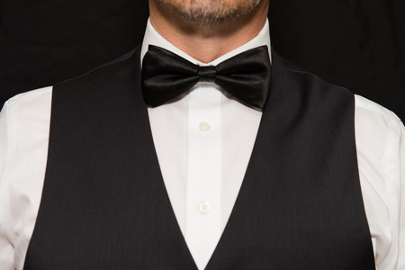 Close-up of gentleman wearing a waistcoat and bowtie.