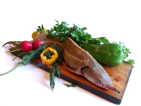 Sturgeon with parsley and pepper on a kitchen photo