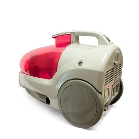 technics: Red household vacuum cleaner on white  Stock Photo