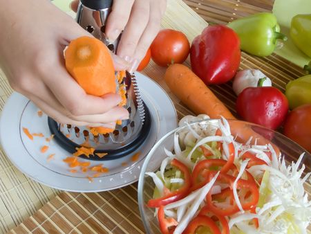 grating: grating of fresh carrot from home kitchen