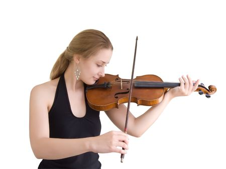 A young girl plays on a violin photo