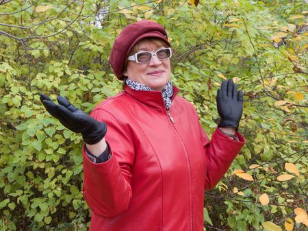 Smiling old lady in red stays in autumn park. Stock Photo - 3696366