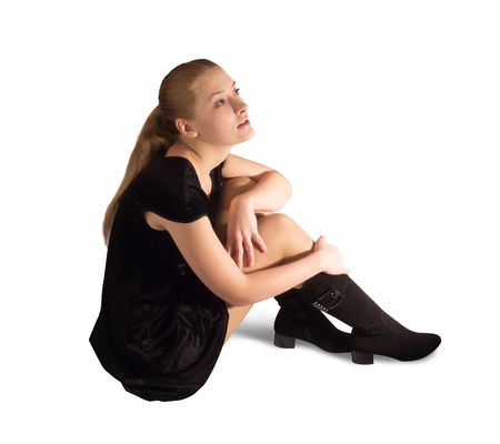velure: Sitting girl in black velure dress and shoes. Isolated on white