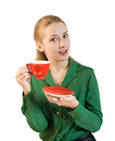girl in green blouse with cup of  tea photo