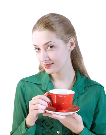 girl in green blouse drinks from a red cup.  photo