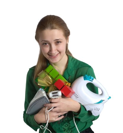 young woman in green with household appliances and present photo