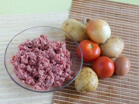 mincing: Raw ingridients for meal on cook table
