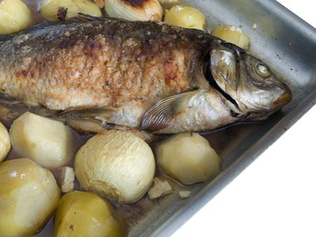 Grilled Carp fish with potatoes on the dish photo
