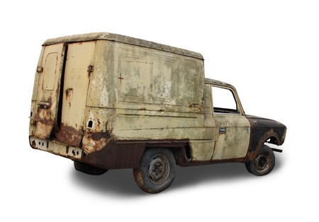 oldie: Old rusted torched car. Isolated over white
