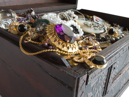 valuables: Wooden treasure chest with valuables,rich background clipping path Stock Photo