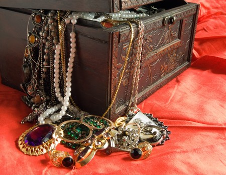 Wooden treasure chest with valuables in red photo