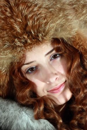 furskin: long haired young woman in polar fox cap