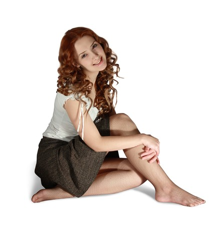 falda corta: Chica en la falda corta sobre fondo blanco