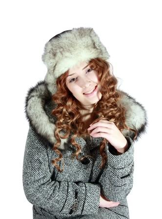 furskin: Girl in coat and polar fox cap on white background Stock Photo