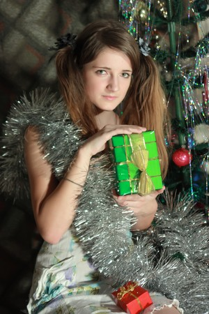 teener: beautiful teenager girl near new year tree at home Stock Photo