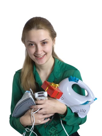 epilator: young woman in green with household appliances and present