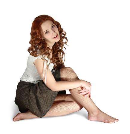 falda corta: Chica en falda corta en el fondo blanco