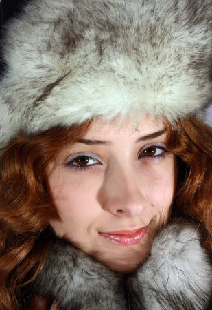 furskin: long haired young woman in in arctic fox cap