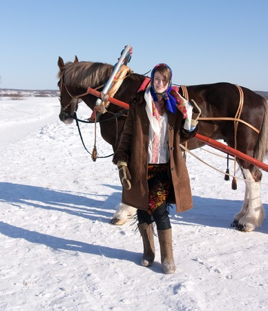 girl in russian traditional clothes and horse-drawn photo