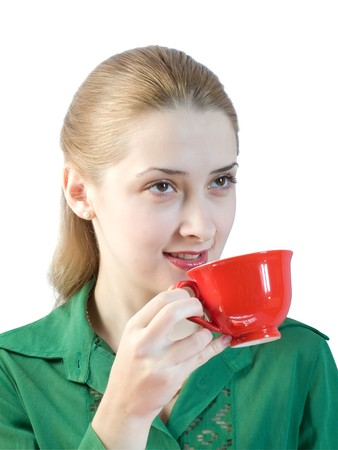 girl in green blouse drinks tea from a red cup. Stock Photo - 4430281