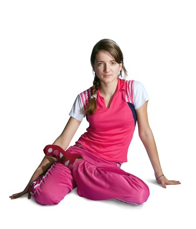 teener: Beautiful young girl in pink activewear  practicing yoga  over white background