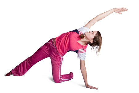 activewear: girl in pink activewear doing fitness exercises. Isolated on white background