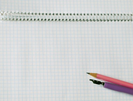 pencil and fountain pen  on squared sheet of a copy-book Stock Photo - 4471398