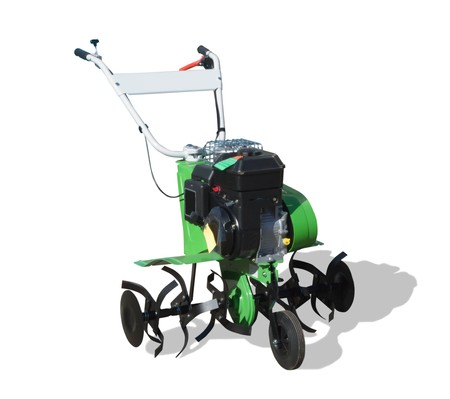 motor hoe: New motor cultivator. Isolated whith path Stock Photo